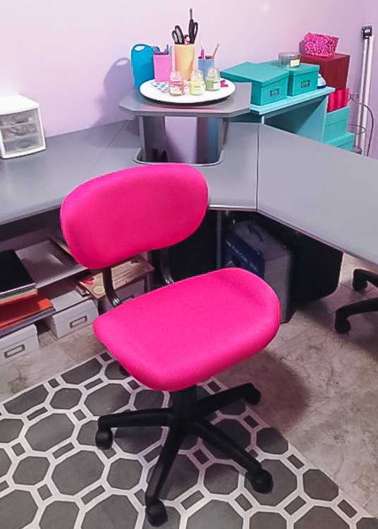 who doesn't LOVE a hot pink chair - check out the corner desk in behind